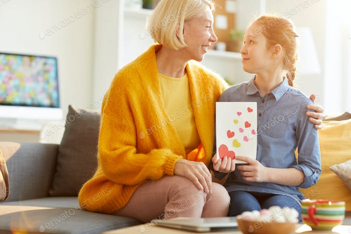 Daughter Giving Valentines Card to Mom