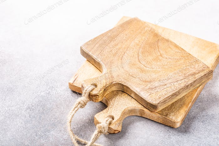 Stack of two rustic wooden cutting boards
