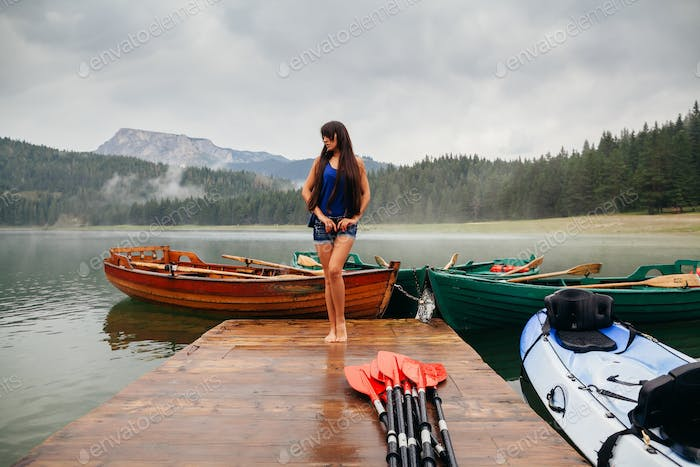 woman relax on lake with kayaks