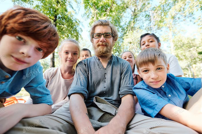 Portrait of teacher with elementary students