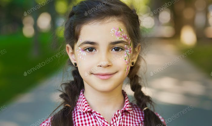 Pretty little girl with painted face