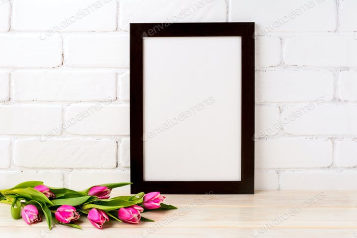 Black brown  frame mockup with magenta tulips bouquet
