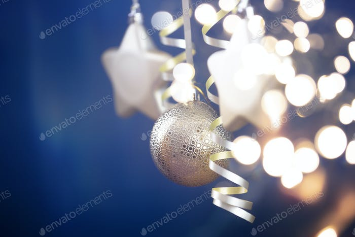Christmas golden star ornaments in holiday night