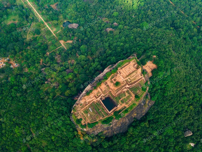 Aerial view of Sigiriya rock at misty morning, Sri Lanka. Drone footage