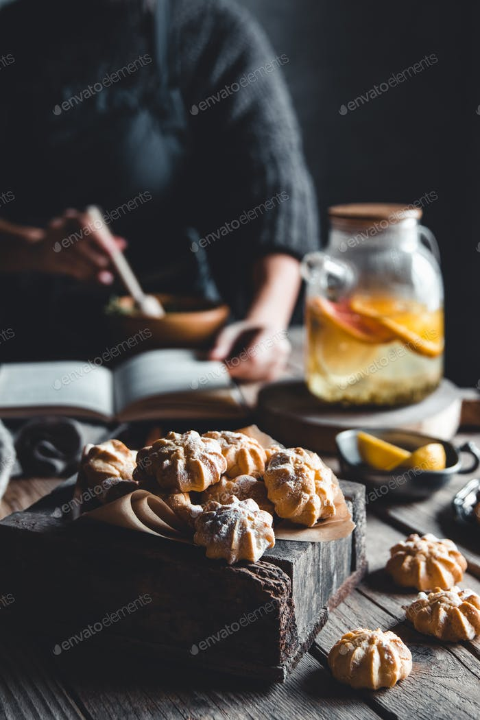 Woman cooks in a vintage kitchen on wooden tablet. Healthy drink, Eco, vegan