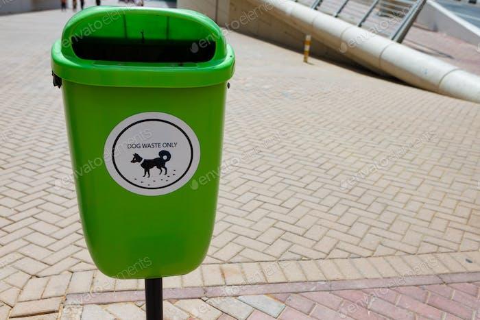 Green recycle bin for dog waste in Dubai