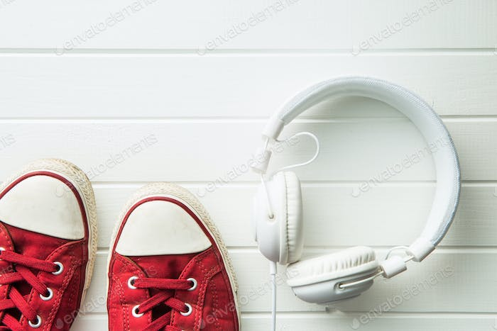 Red sneakers and headphones.
