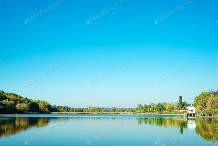Amazing landscape of lake with clear green water and Perfect blue sky. Ukraine