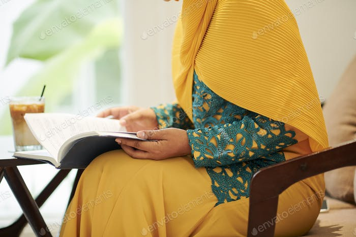 Muslim female student reading book