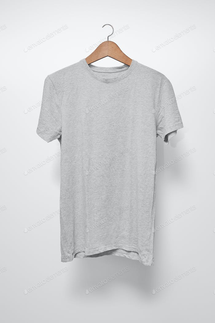 Grey T-Shirt on a hanger against a white background