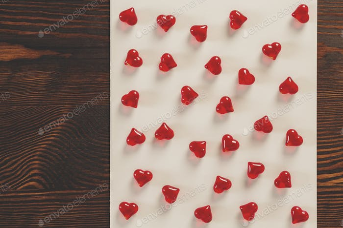 Red hearts on paper