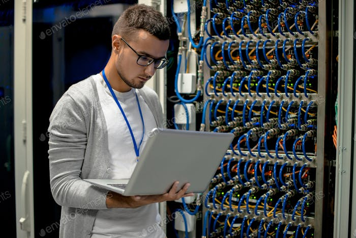 Young Engineer Managing Supercomputer Servers