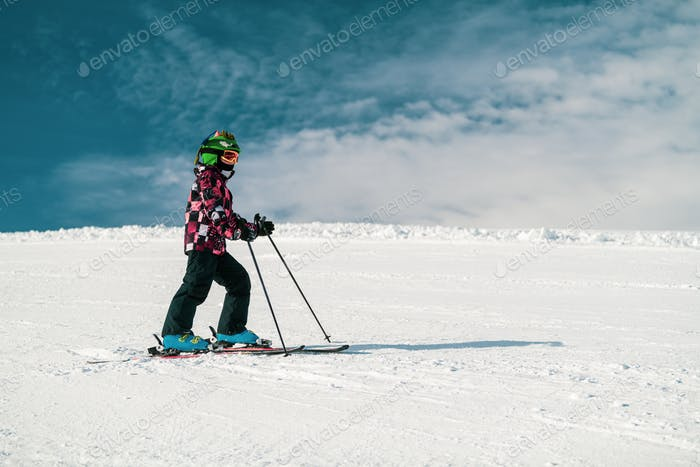 Cute Child Skiing Down the Slope