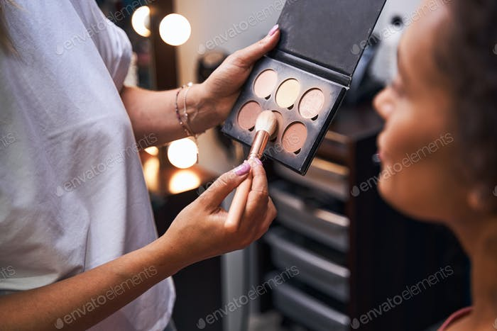 Close up of stylist using professional cosmetics