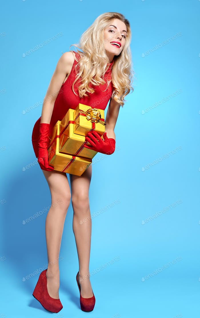 Woman portrait with gifts boxes smiling