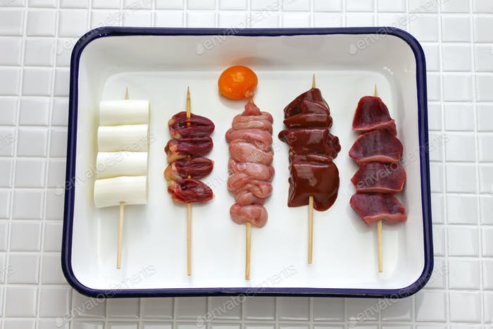 yakitori before grilling , japanese grilled chicken skewers variety