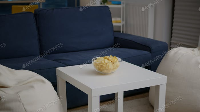 Modern empty apartament with nobody in it is ready for night party having chips bowl