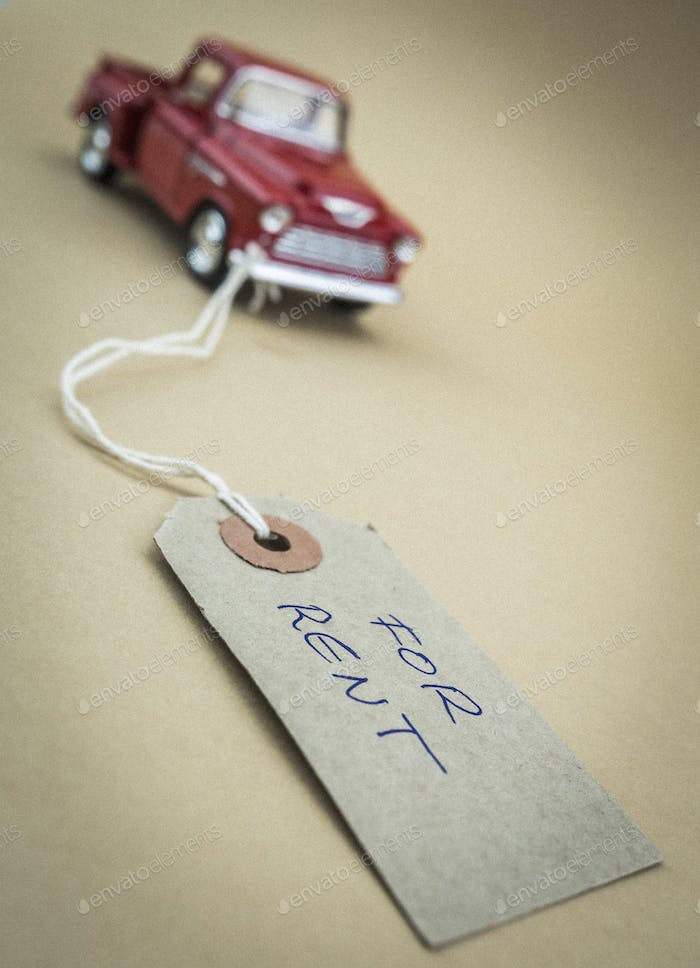 Old miniature car with marked label for sale, business concept