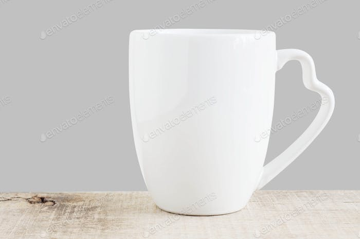 White cup on wooden