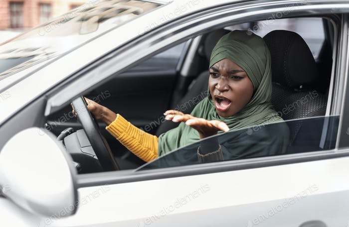 Angry Black Islamic Woman Driving Car, Arguing With Someone In Traffic Jam