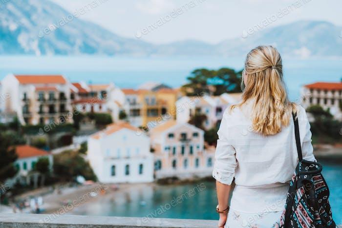 Tourist female enjoying greek small vivid colored Assos village. Kefalonia, Greece. Sommer vacation