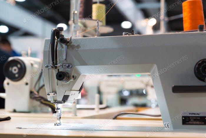 Overlock machine closeup, nobody, clothing sew