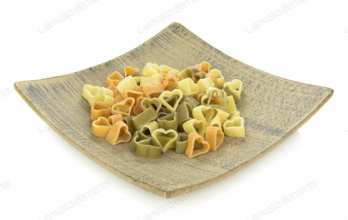 Pasta Hearts on Wooden Plate