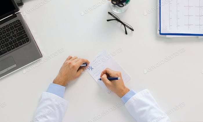 doctor hands with prescription at clinic