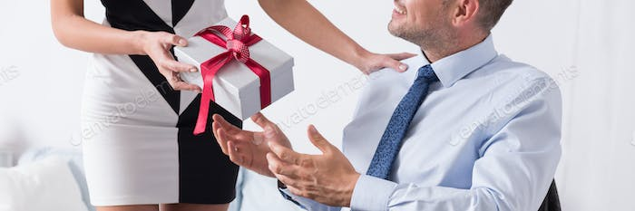 Man taking present from wife