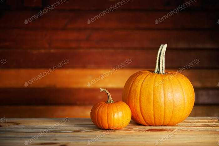 Two pumpkins on wooden table