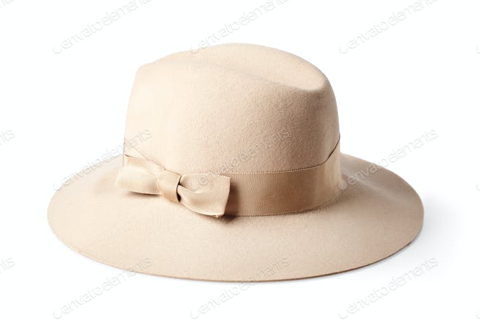beige female felt hat isolated on white background