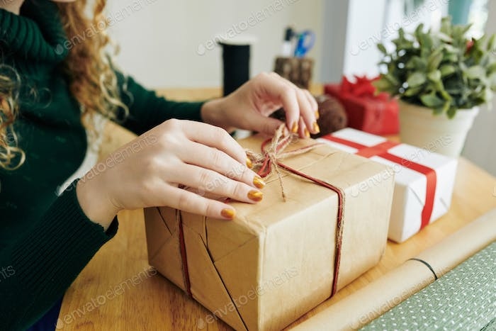 Woman opening Christmas gift