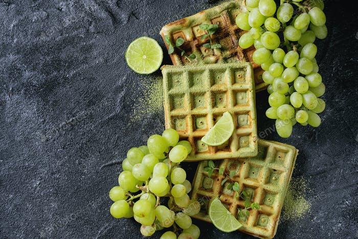 Green waffles with grapes
