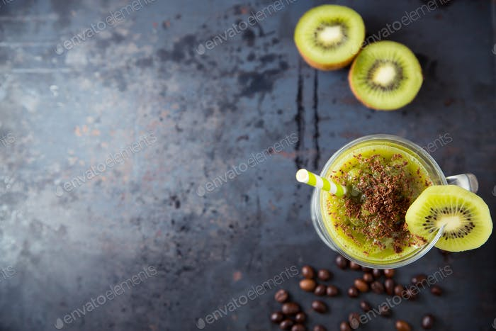 Green smoothie of kiwi sprinkled with chocolate