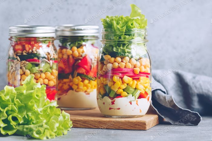Jars with layering salads