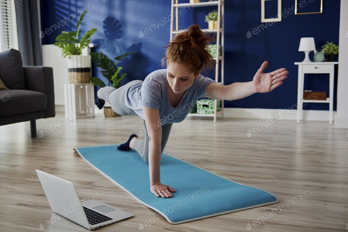 Woman taking online lesson  of home workout