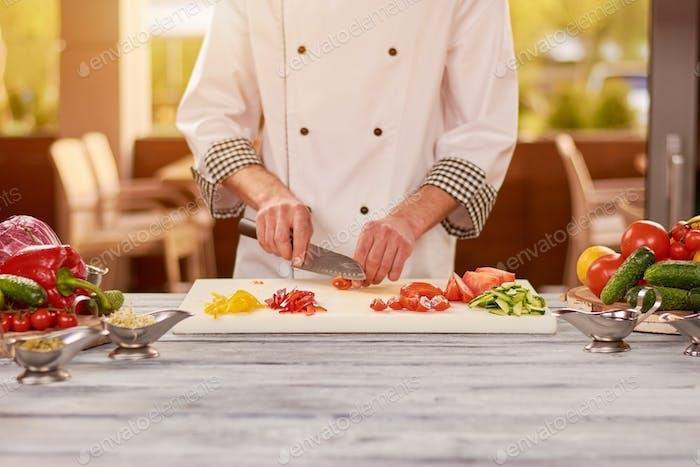 Chef preparing food at professional kitchen