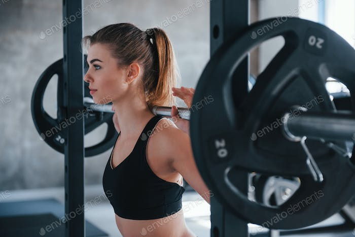 Healthy hobby. Photo of gorgeous blonde woman in the gym at her weekend time