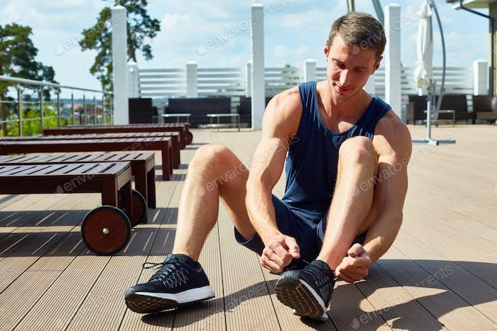 Sportsman Tying Training Shoes