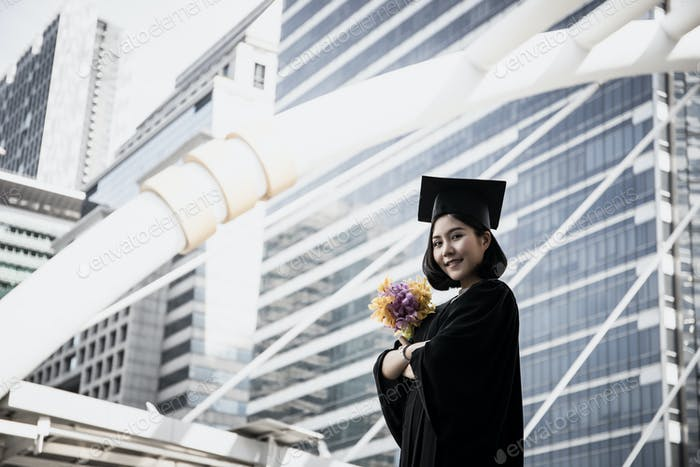 Portrait of Asian student graduate being congratulated.