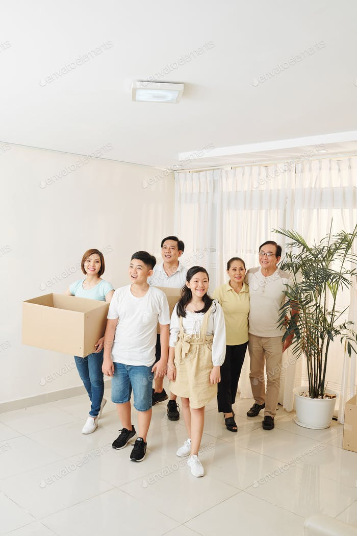 Vietnamese family entering new apartment