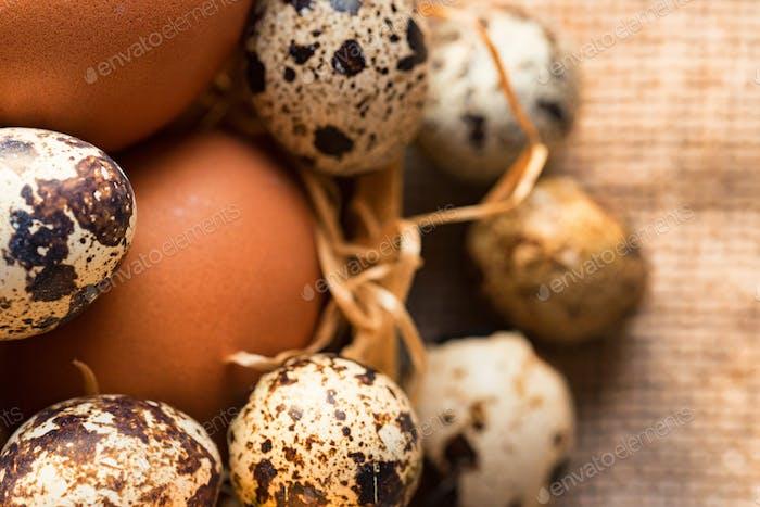Fresh farm brown eggs on rustic background