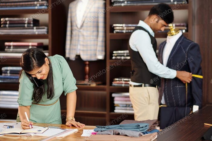 Tailors working in atelier
