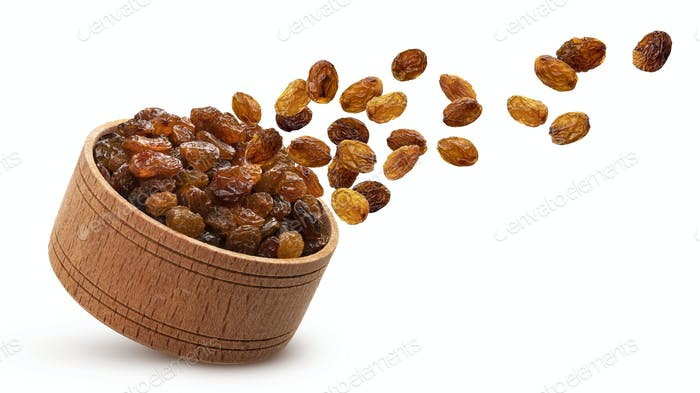 Raisins in wooden bowl isolated on white background