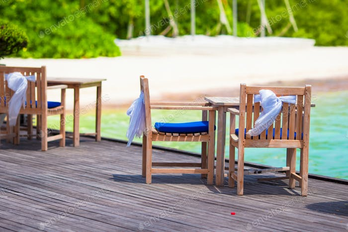 Summer empty outdoor cafe at beautiful tropical island