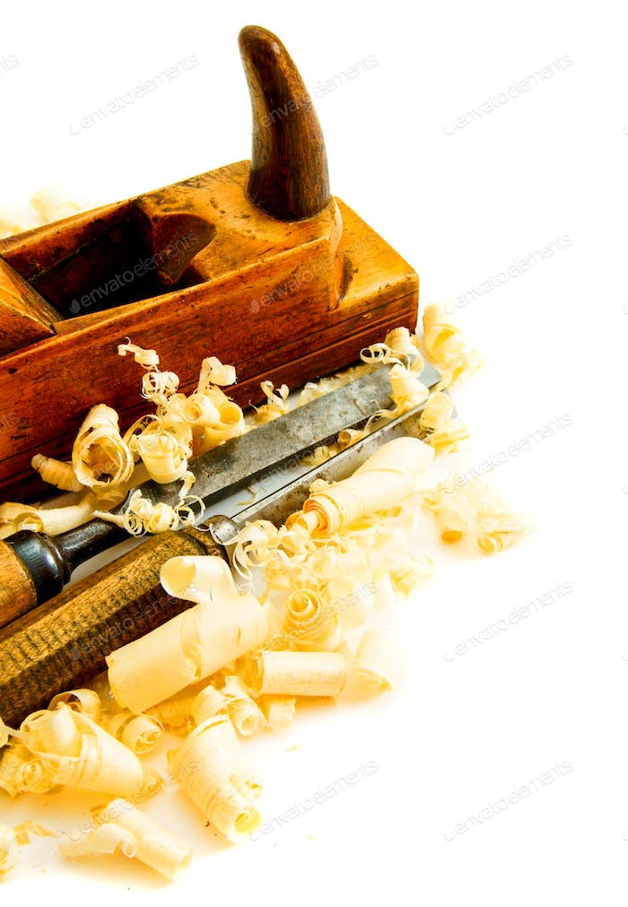 Joiner's tools ( plane, chisel) on a white background.