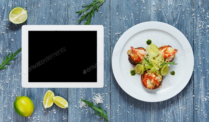 Seafood dish top view with copy space at tablet