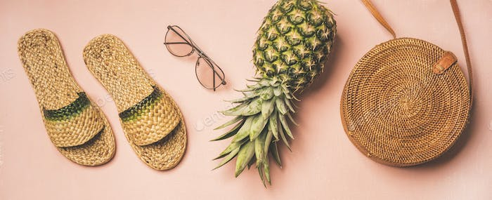 Summer apparel fashionable items over pastel background, wide composition