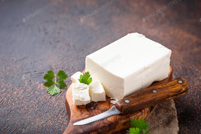 Feta cheese on rusty background