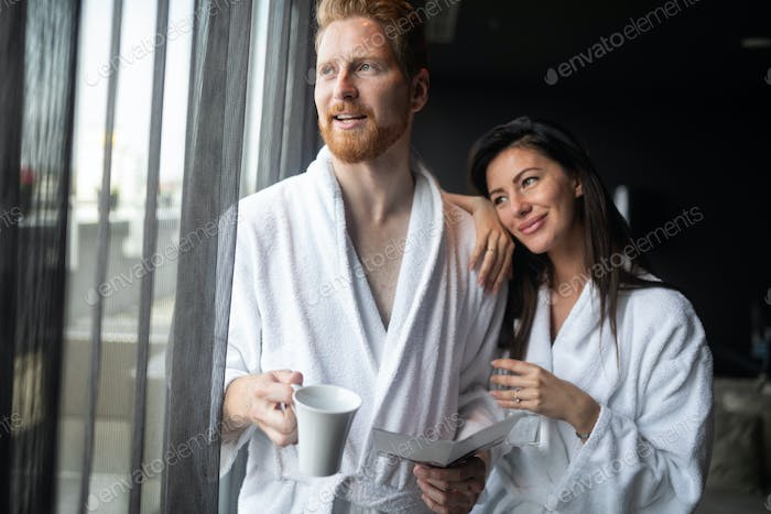 Happy couple enjoying treatments and relaxing at wellness spa center